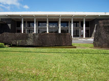 Historic Naha Stone at Hawaiian Libraru. The historic Naha stone in front of the Hilo Public Library in Hawaii is believed to be what King Kamehameha lifted to Stock Images