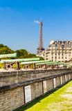 Historic Napoleonic artillery gun near National Residence of Invalids. With the Eiffel tower in the background Royalty Free Stock Photos