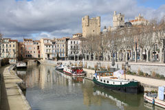 Historic Narbonne in Languedoc-Roussillon, South France. Town center with canal Stock Images