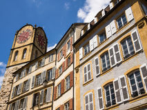 Historic Neuchatel in Switzerland. Clock tower and historic buildings on the Rue du Chateau in Neuchatel, Switzerland Royalty Free Stock Photography