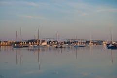 Historic Newport, Rhode Island at Dawn. The sun rises over the Newport Bridge stock photos