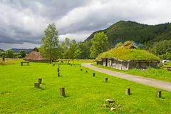 Historic Norwegian loghouse. Rebuilt Norwegian loghouse with grass on roof Stock Image