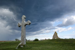 Historic objects. Historic cross and chapel ruin in stormy weather Royalty Free Stock Photography