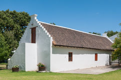 Historic old building on a farm. CAPE TOWN, SOUTH AFRICA - DECEMBER 15, 2014:  Historic old building on the farm Lourensford near Somerset West Stock Photos