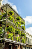 Historic old buildings with iron balconies in French Quarter Stock Photos