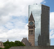 Historic old City Hall, Toronto in Front of modern Building. Historic City Hall in Toronto in front old modern building with reflection Royalty Free Stock Images