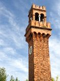 Historic old high Bell Tower with clock in Murano near Venice Stock Images