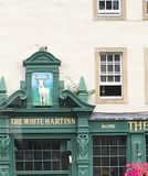 Historic Old Inn. A white stag sculpted above the old historic White Stag Inn in Edinburgh , Scotland stock photo