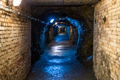 Corridors and drifts in the mine. Historic old mine and its dark corridors stock images