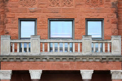Historic Old Red Sandstone Building Windows Brick and Balcony Stock Images