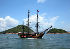 Historic old ship in the ocean. Near the islands Royalty Free Stock Image