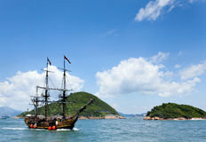 Historic old ship in the ocean. Near the islands and beautiful panorama Stock Photography