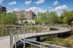 Old Fourth Ward Park with Ponce City Market in the background. Historic Old 4th Ward sunken park in spring time with Ponce City Market in the background. The Stock Photos