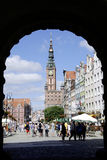 Historic Old Town of Gdansk in Poland. People in the Historic Old Town with the town hall on Long Market of Gdansk in Poland Stock Images
