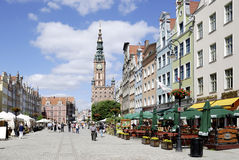 Historic Old Town of Gdansk in Poland. People in the Historic Old Town with the town hall on Long Market of Gdansk in Poland Stock Image