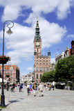 Historic Old Town of Gdansk in Poland. People in the Historic Old Town with the town hall on Long Market of Gdansk in Poland Royalty Free Stock Photo