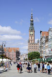 Historic Old Town of Gdansk in Poland. People in the Historic Old Town with the town hall on Long Market of Gdansk in Poland Royalty Free Stock Photography