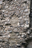 Historic old wall. Closeup of an old historic wall with old and different bricks royalty free stock photography