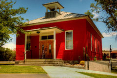 Historic one room schoolhouse. Located in Wickenburg, Arizona, this little red schoolhouse was abandoned in and moved from the Vulture Gold Mine in 1895. School Royalty Free Stock Photos
