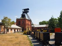 Historic ore mine headgear and buildings. Tracks and carriage stock images