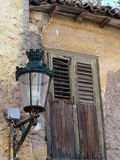 Wooden Window Shutters on Historic Plaka House, Athens, Greece. An historic original house in the Plaka Precinct, Athens, Greece, with an old style street lamp Stock Photo