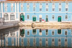 Historic palace with reflection in water in the historic center of Lisbon in Portugal. royalty free stock photo