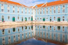 Historic palace with reflection in water in the historic center of Lisbon in Portugal. stock photos