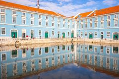Historic palace with reflection in water in the historic center of Lisbon in Portugal. royalty free stock photography