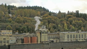 Historic Paper Mill Plant in Oregon City along Willamette River with Moving Clouds Time Lapse stock video footage