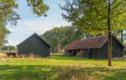 Historic barns in a Dutch landscape. Historic, partially open, barns built at the end of the 19th century. The barns were built at the time of a large Dutch royalty free stock images