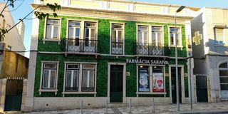 Historic Pharmacy Building in Loures City, Portugal. Historic Pharmacy Building in Loures City. Facade of green tile royalty free stock images