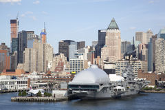 Historic Pier. The view of historic military ship with Manhattan skyline in a background (New York City Royalty Free Stock Photos