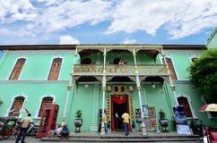 Historic Pinang Peranakan Mansion in Georgetown, Penang. Penang, Malaysia - December 29, 2011: There are some tourists visiting and exploring around the Historic royalty free stock photography