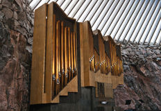 Historic pipe organ in church in rock Royalty Free Stock Photo