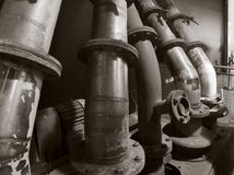 Historic pipes. Some old pipes in brown toned ambiance stock photo