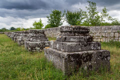 Historic places - ruins. Segment of ancient column located in Adamclisi, Romania royalty free stock photography
