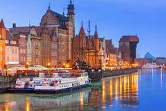 Historic port crane over Motlawa river in Gdansk at night Royalty Free Stock Photos