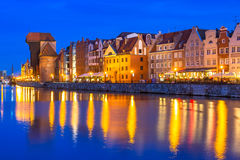 Historic port crane and ship over Motlawa river in Gdansk at night Stock Photography