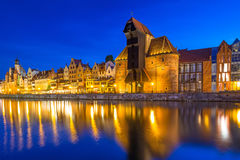 Historic port crane and ship over Motlawa river in Gdansk at night Stock Photos