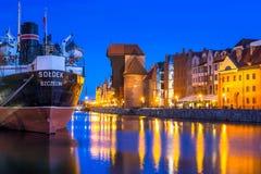 Historic port crane and ship over Motlawa river Royalty Free Stock Photos