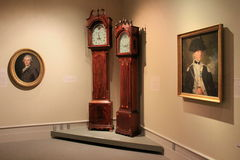 Historic portraits of important men and grandfather clocks, Albany Institute of History and Art,NY,2016 Stock Photos