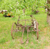 An historic potato digger used by early pioneers. A device on wheels used to dig produce in the early years of  farming in british columbia Stock Photography