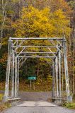 Historic Pratt Truss Bridge - East Fork Greenbrier River, West Virginia. An autumn view of a historic one-lane Pratt through truss bridge over the East Fork Royalty Free Stock Image