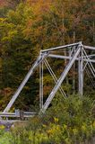 Historic Pratt Truss Bridge - East Fork Greenbrier River, West Virginia. An autumn view of a historic one-lane Pratt through truss bridge over the East Fork Stock Image