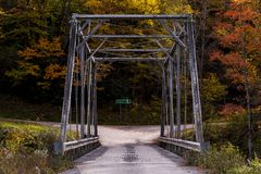Historic Pratt Truss Bridge - East Fork Greenbrier River, West Virginia. An autumn view of a historic one-lane Pratt through truss bridge over the East Fork Stock Photos