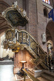 Historic pulpit in The Archcathedral Basilica of St. Peter and St. Paul in Poznan Royalty Free Stock Image