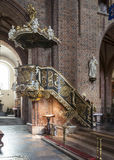 Historic pulpit in The Archcathedral Basilica of St. Peter and St. Paul in Poznan Royalty Free Stock Photography
