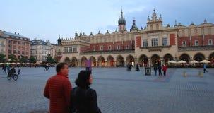 Historic quarter of Krakow, Poland - Main Market Square - Cloth Hall - Sukiennice stock video footage