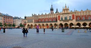Historic quarter of Krakow, Poland - Main Market Square - Cloth Hall - Sukiennice stock video footage