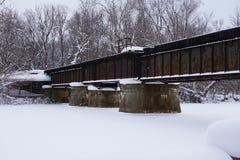 1907 Historic Railroad Bridge Over Little Rabbit River in Michigan stock image